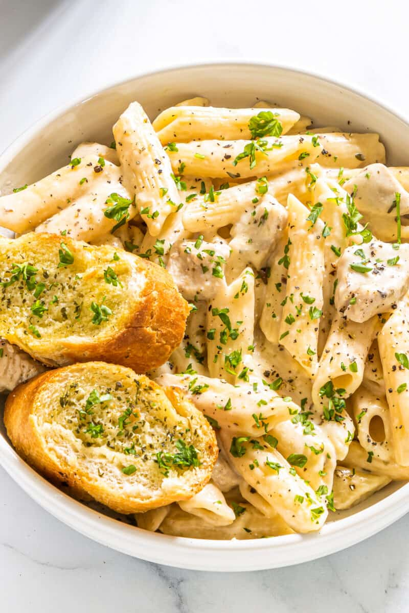 pasta in bowl with garlic bread