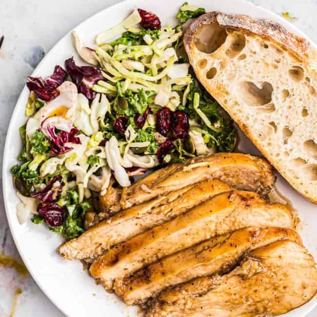 sliced bourbon chicken with salad