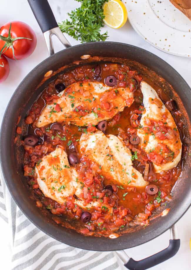 mediterranean chicken with sauce in skillet