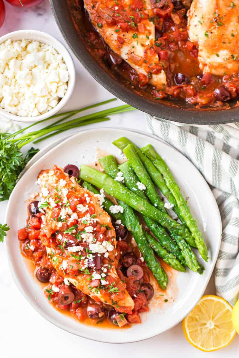 Mediterranean chicken topped with feta next to green beans
