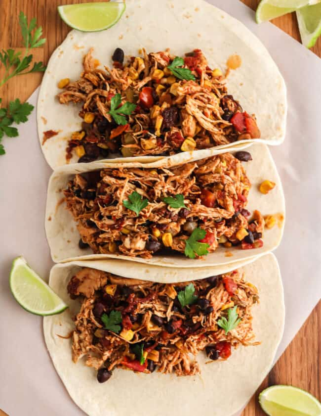 three shredded chicken tacos