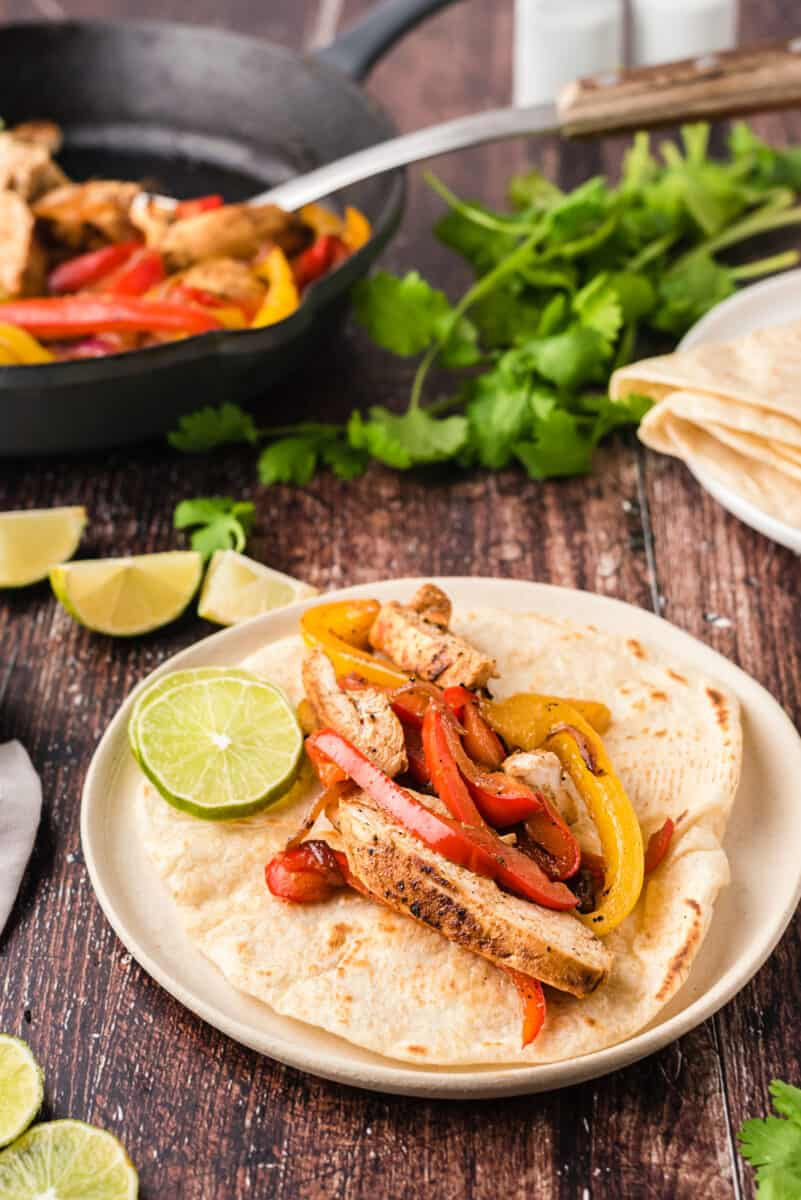 chicken fajitas with veggies in tortilla