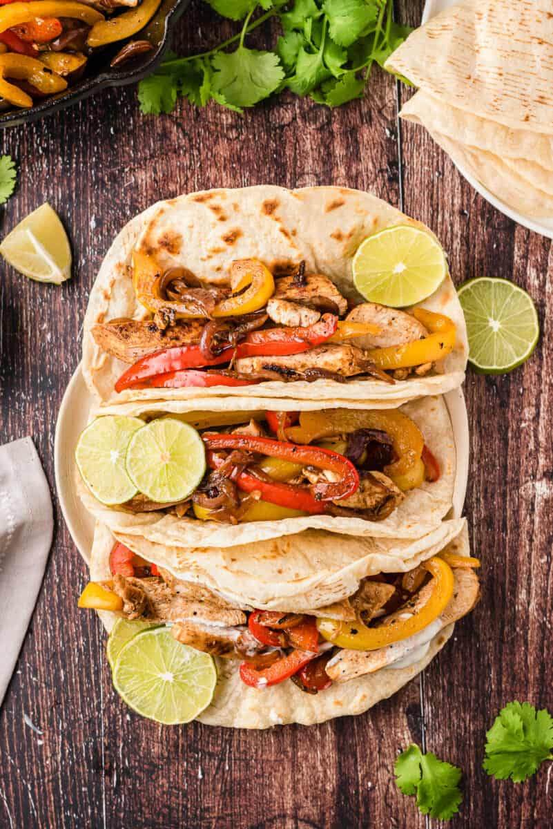 three tortillas filled with chicken fajitas