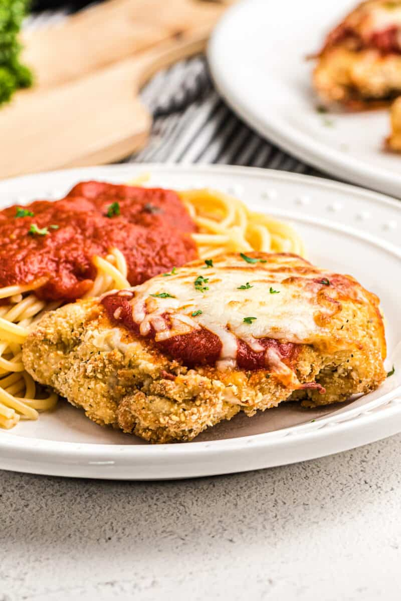 crispy air fried chicken parmesan on white plate