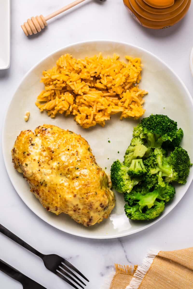 Plate with chicken, rice, and broccoli.