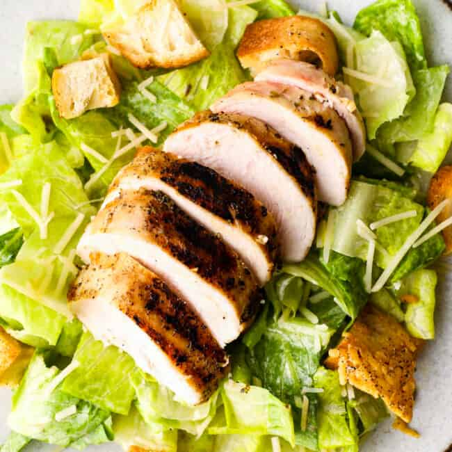 up close overhead image of caesar salad with chicken