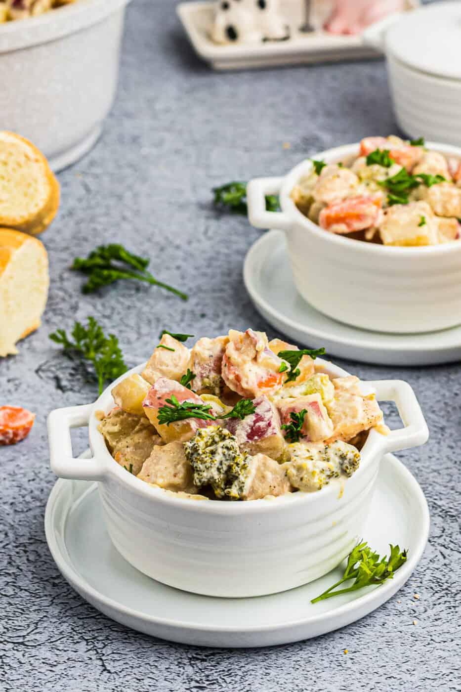 white bowls with creamy chicken stew