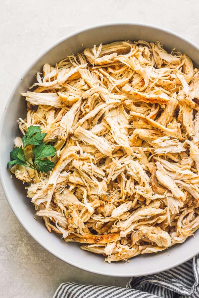 Crockpot shredded chicken in bowl.