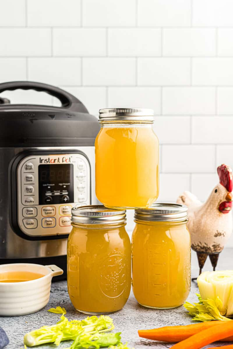 Mason jars filled with chicken stock.
