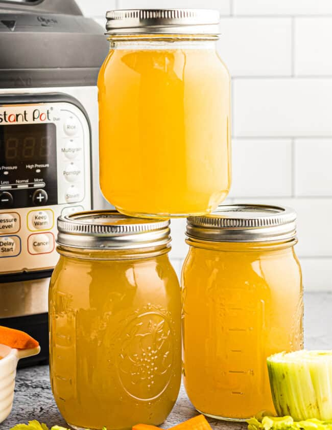 3 mason jars filled with instant pot chicken stock