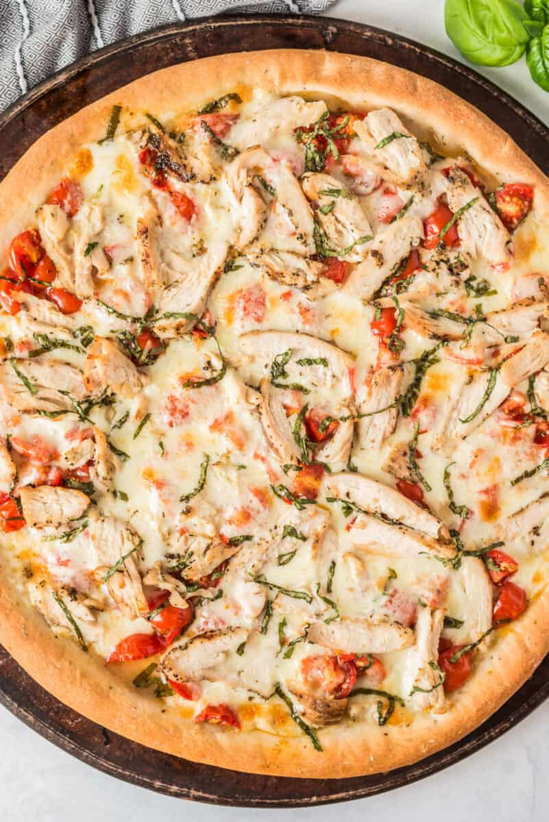 up close image of chicken margherita pizza