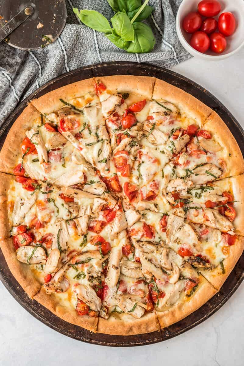 sliced margherita chicken pizza