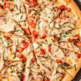up close image of sliced chicken margherita pizza