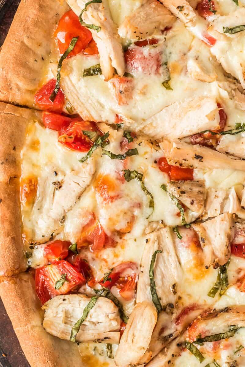 slice of homemade chicken margherita pizza
