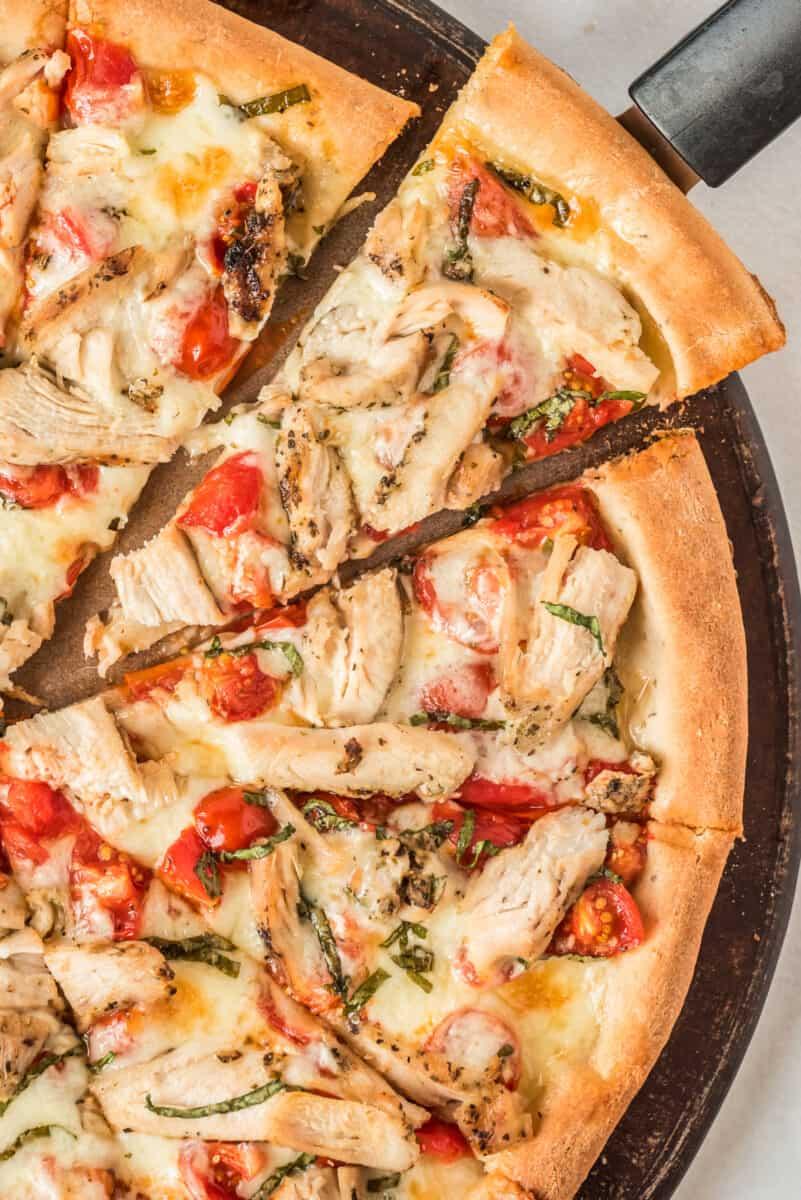 slice of chicken margherita pizza