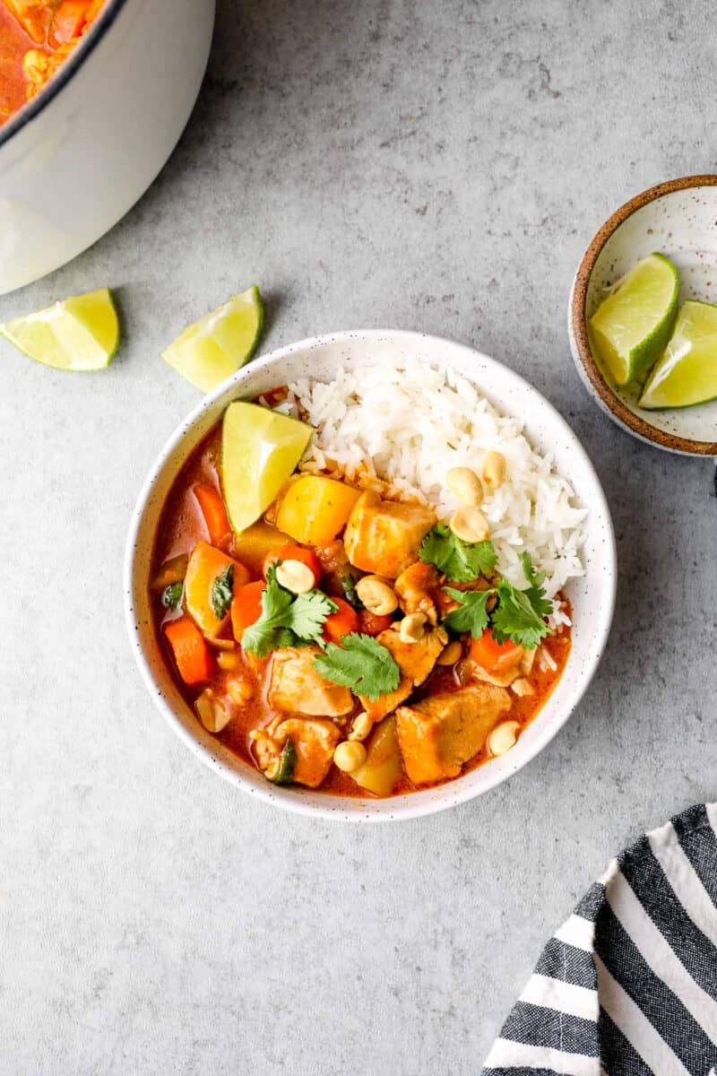 massaman chicken curry in white bowl with rice