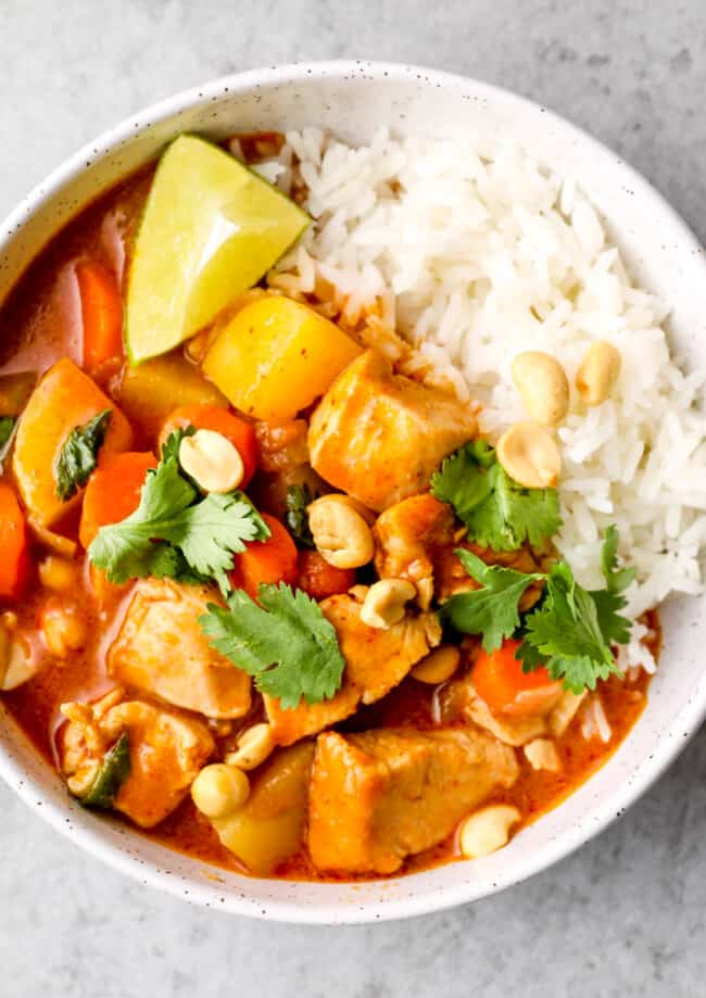 up close image of chicken massaman curry with white rice