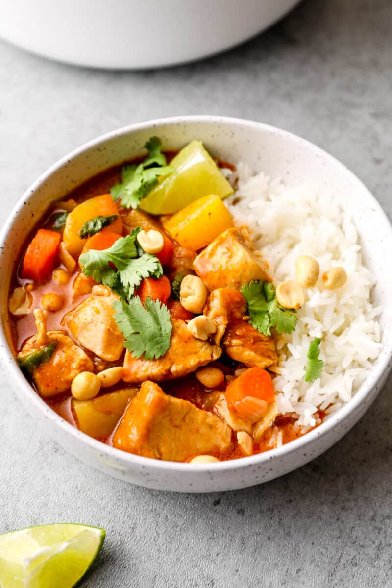 side image of massaman curry garnished with peanuts