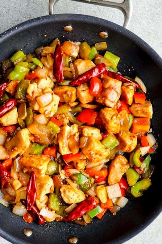 up close image of black skillet with szechuan chicken