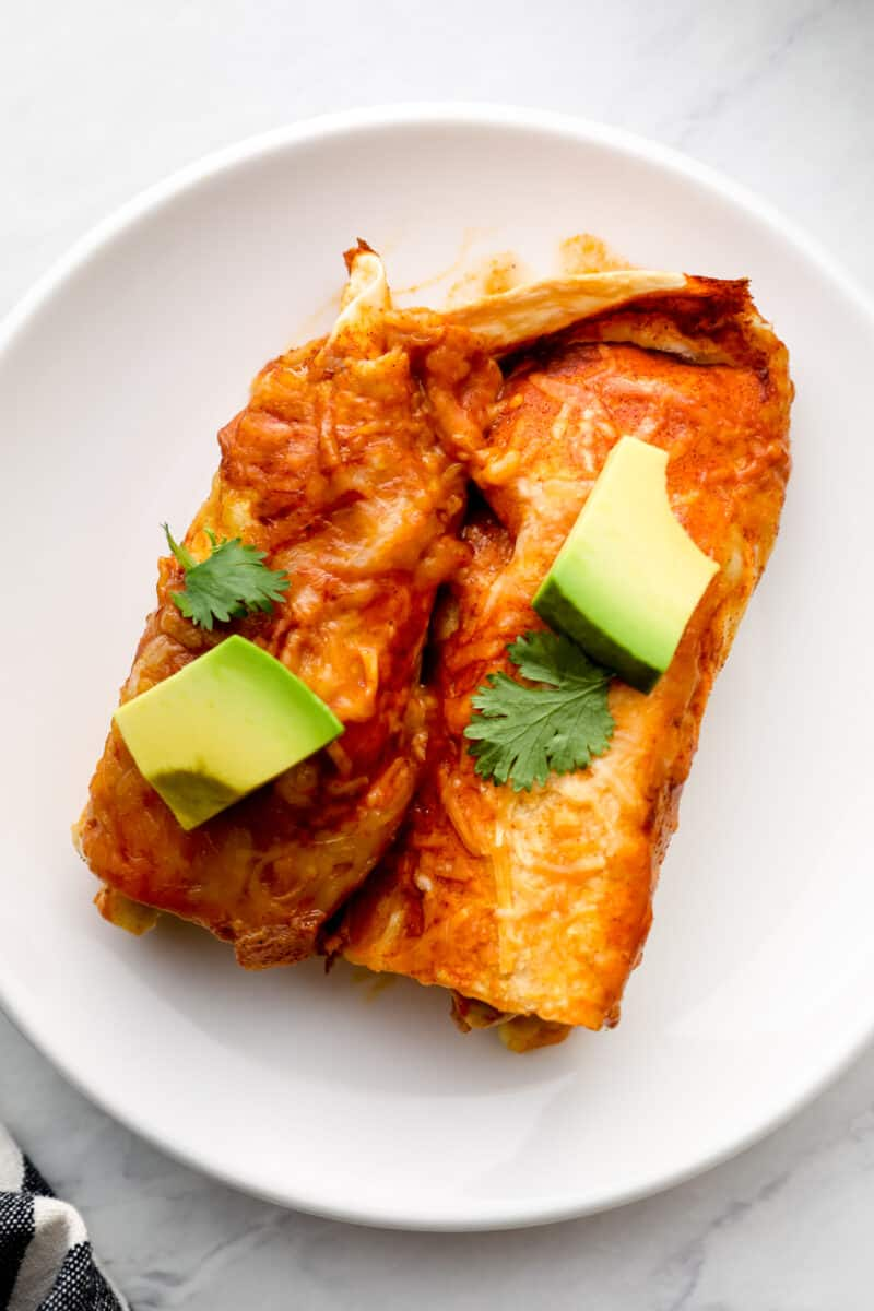 A plate of chicken enchiladas.