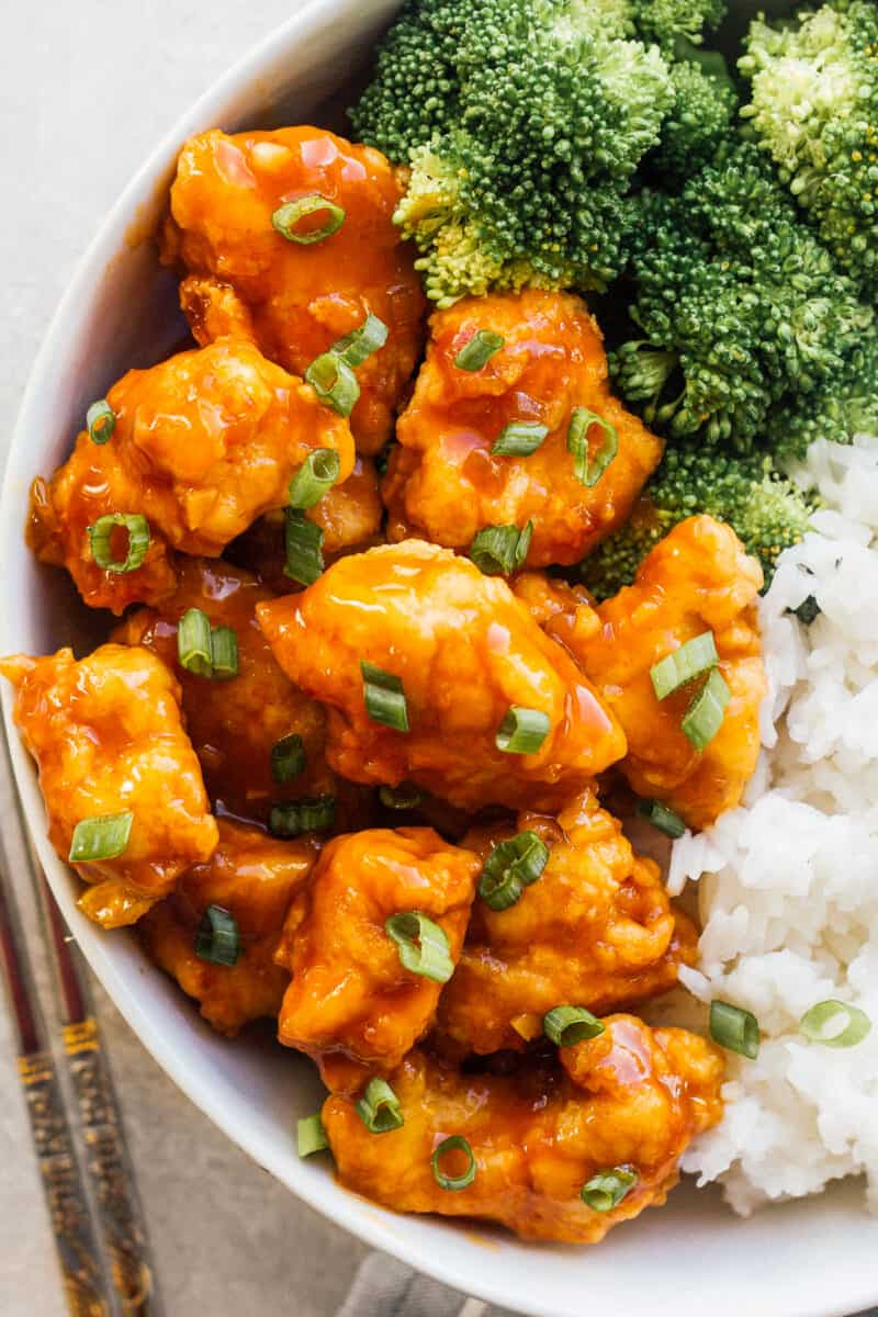orange chicken topped with green onion