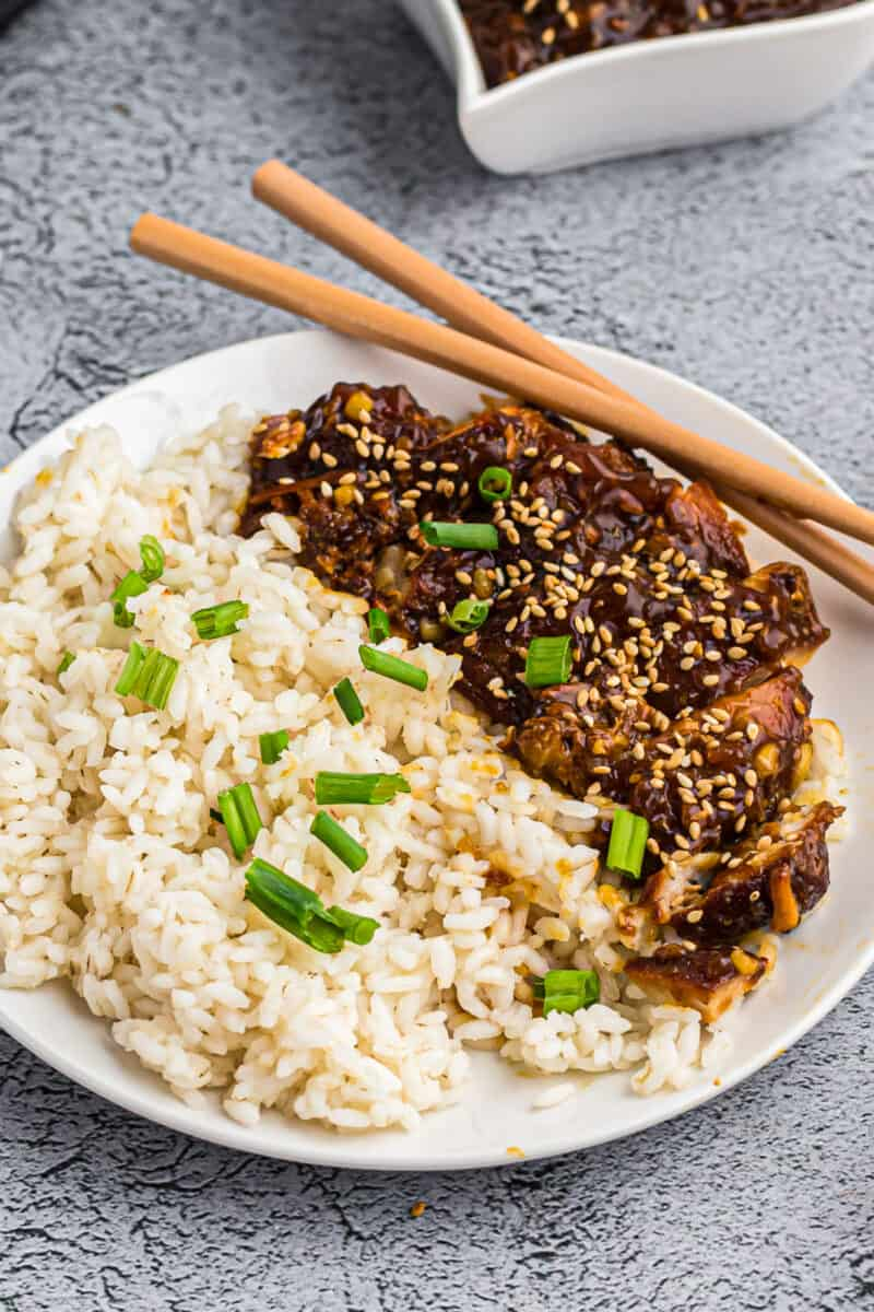 instant pot chicken teriyaki with rice on plate garnished with green onion