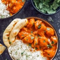 one bowl of chicken tikka masala with naan
