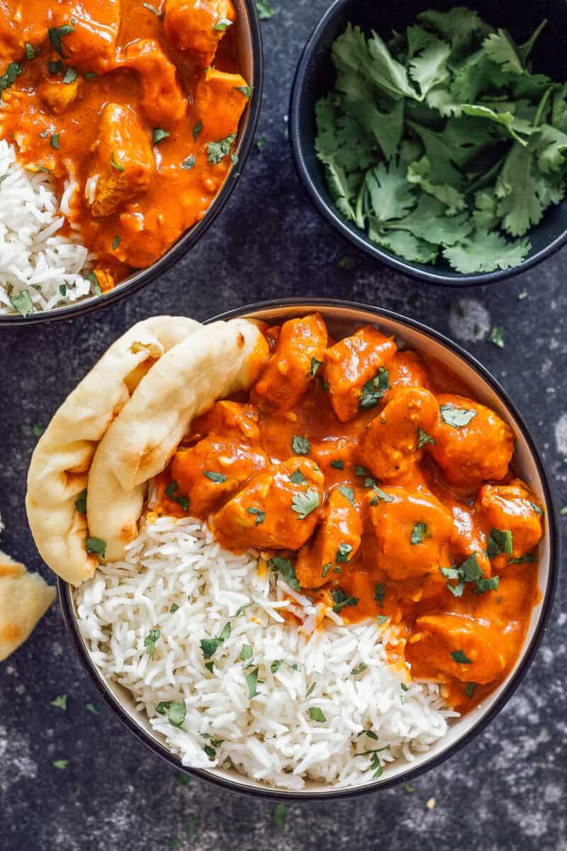 One bowl of tikka masala with naan.