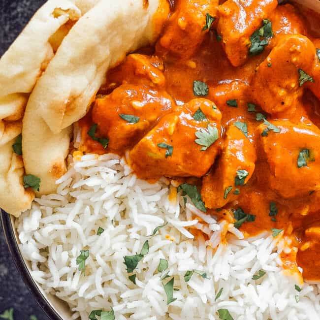 up close image of bowl of chicken tikka masala with rice