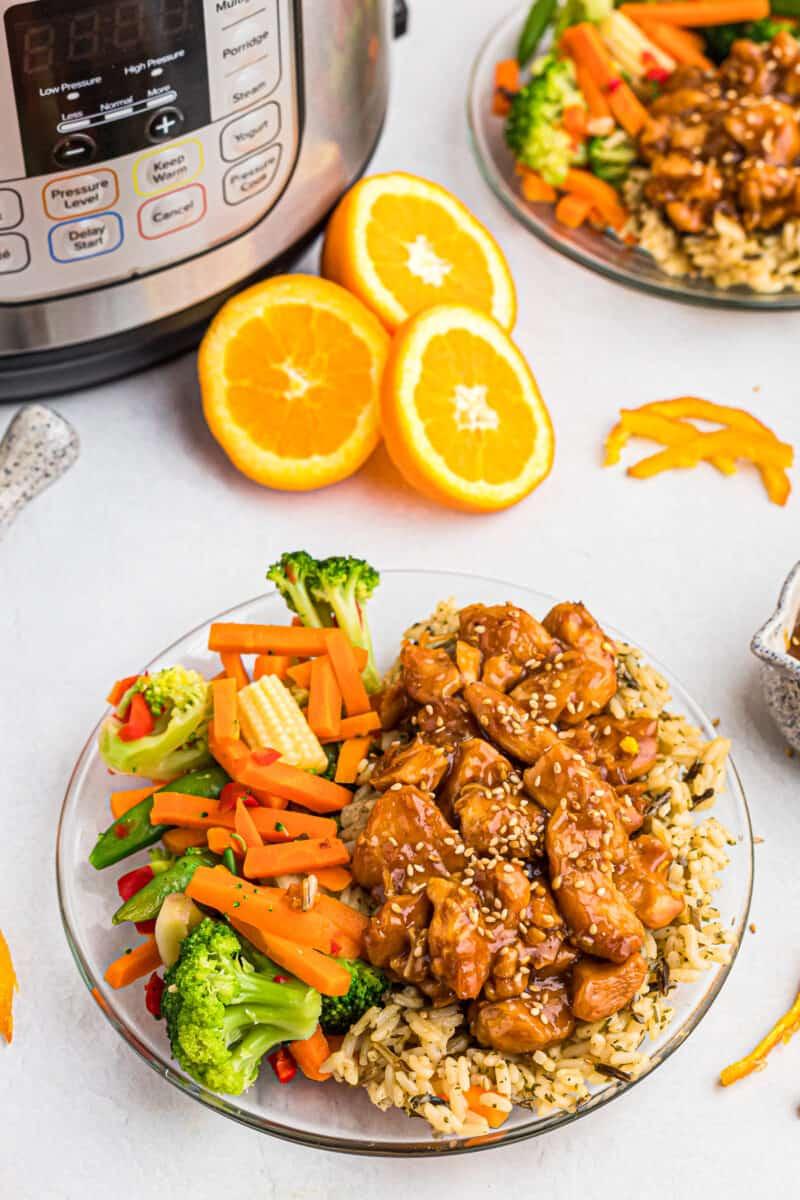 instant pot orange chicken on plate with veggies