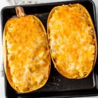 cheesy chicken spaghetti squash on baking sheet