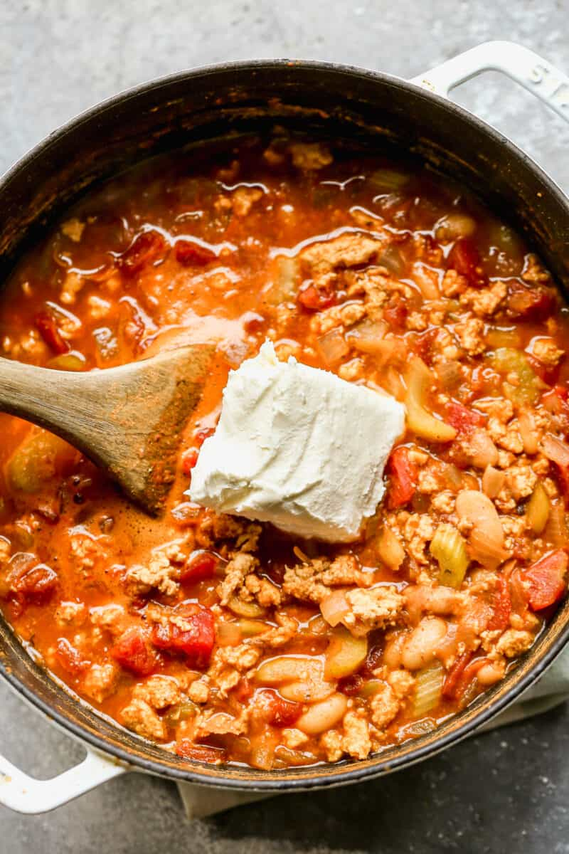 adding cream cheese to buffalo chicken chili