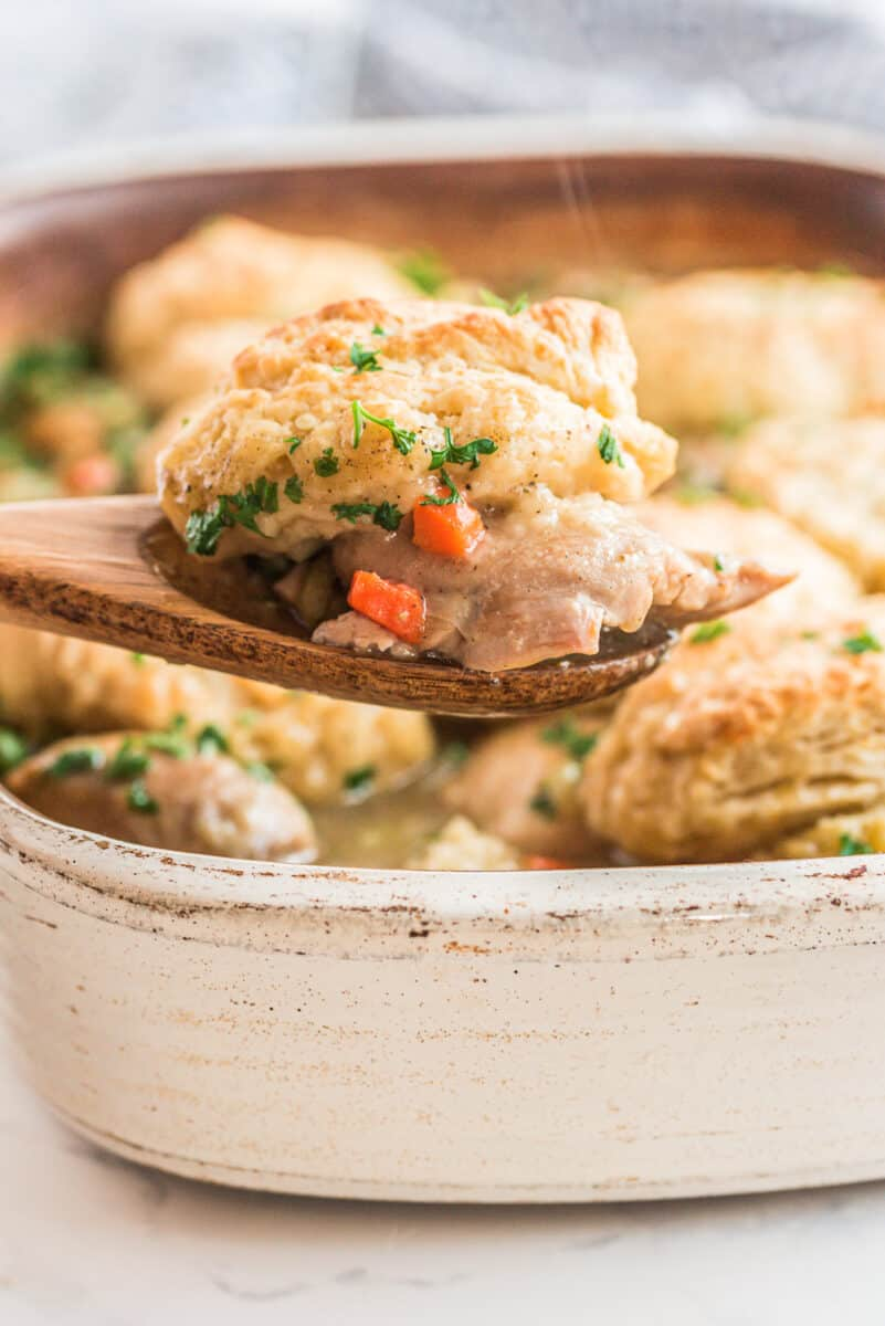 lifting up chicken biscuit bake with wooden spoon