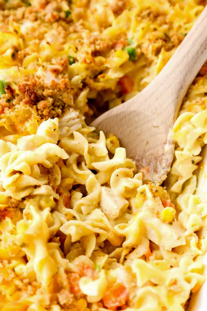 chicken noodle casserole with wooden spoon