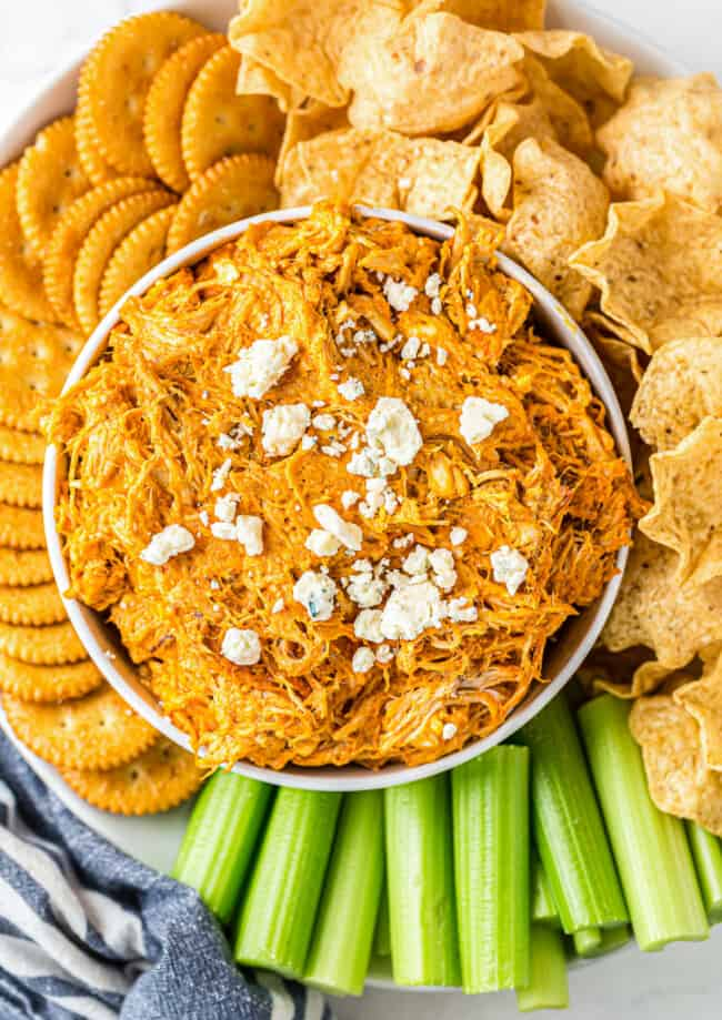 bowl of buffalo chicken dip with chips and crackers