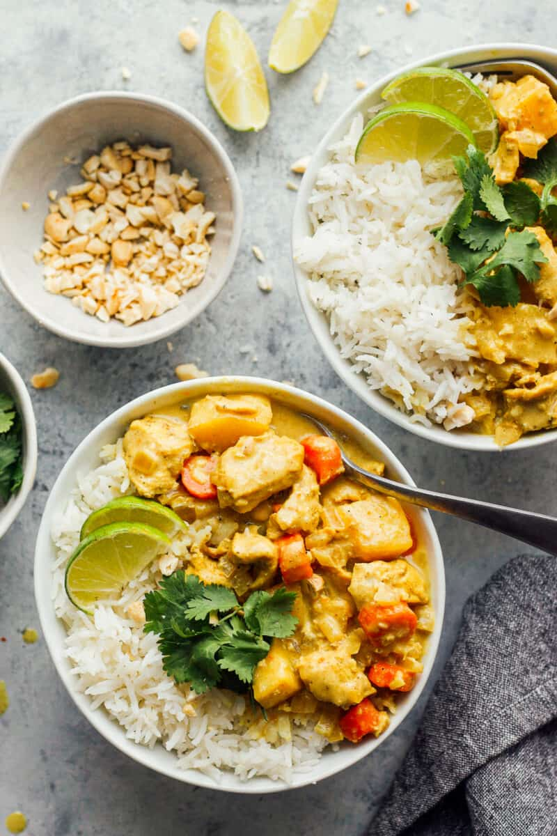 crockpot chicken curry in bowls with rice