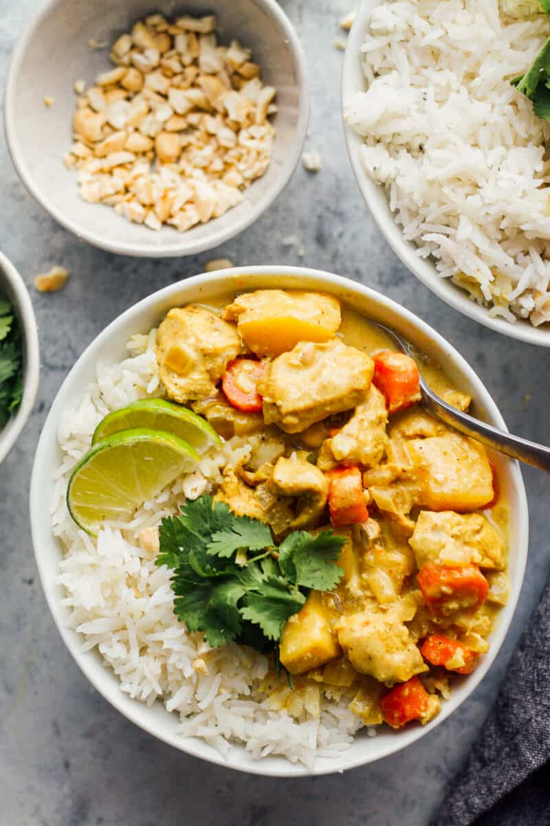 two bowls with chicken curry made in slow cooker