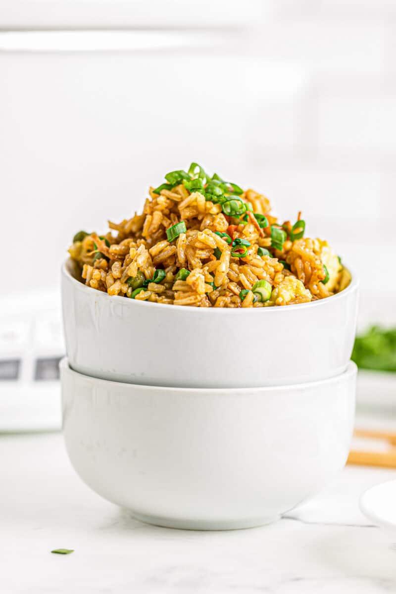 side shot of crockpot chicken fried rice in bowls