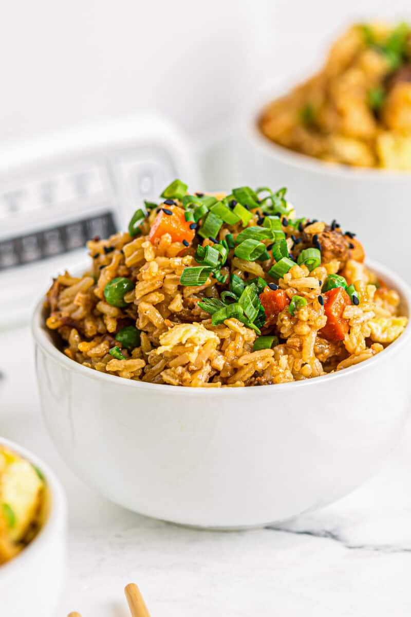 side shot of slow cooker chicken fried rice in bowls