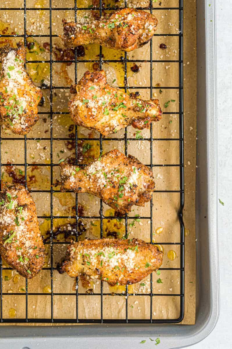 garlic parmesan wings on baking sheet