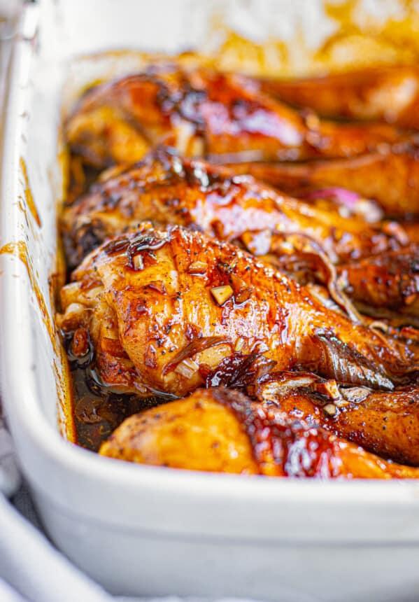 honey soy chicken drumsticks in baking dish