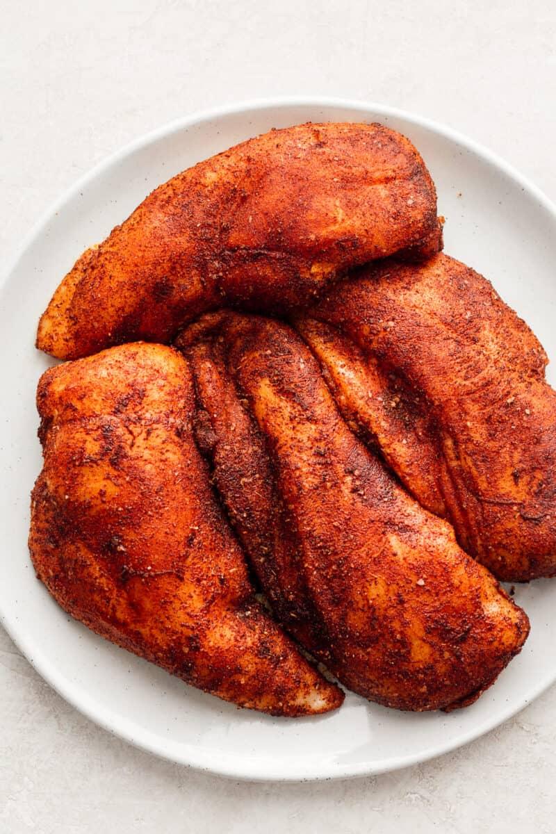 bbq seasoned chicken breasts on plate