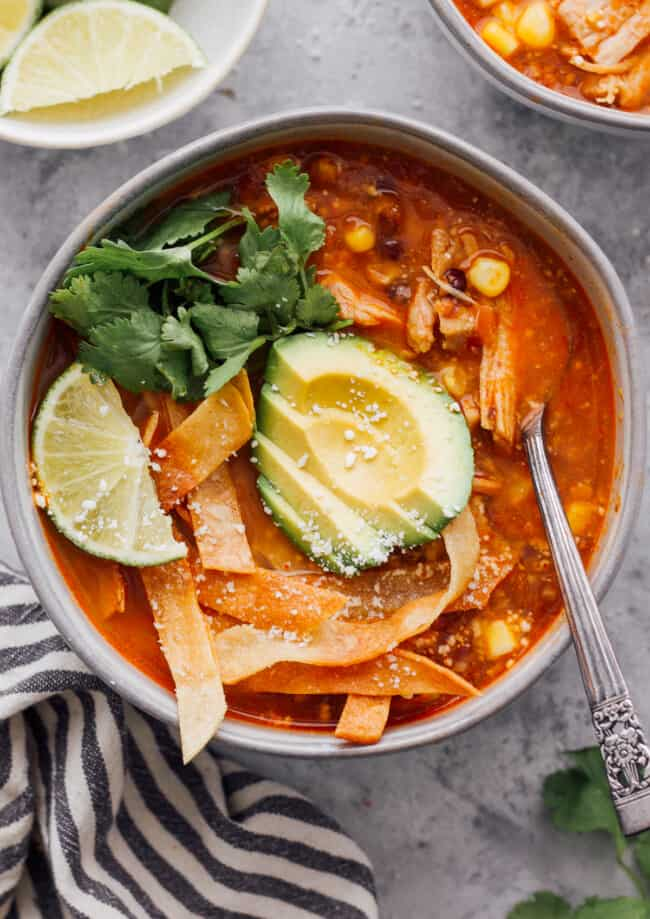 instant pot chicken tortilla soup with avocado, cilantro, and tortillas