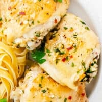 garlic parmesan chicken thighs on plate with pasta