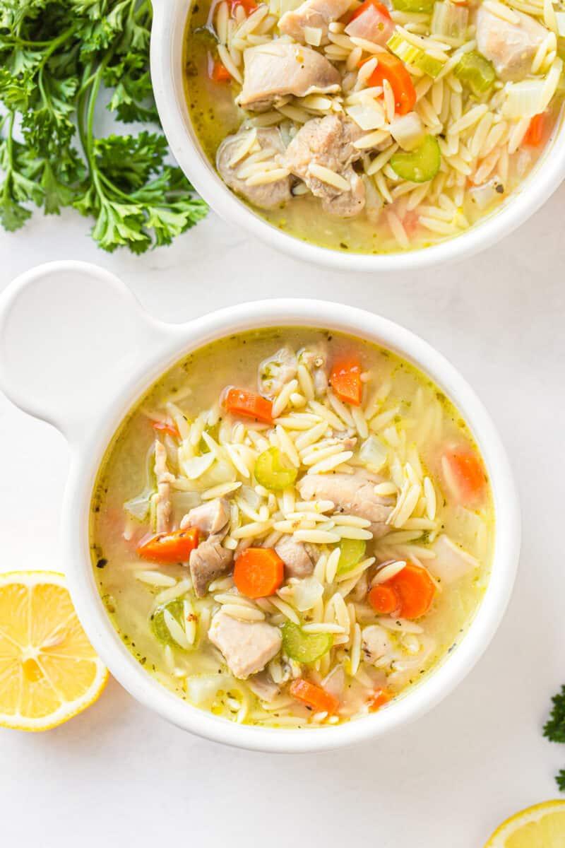 lemon orzo chicken soup in white bowls