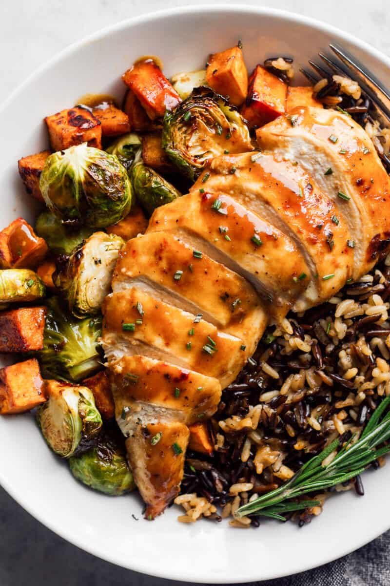 sliced maple dijon chicken with rice and vegetables