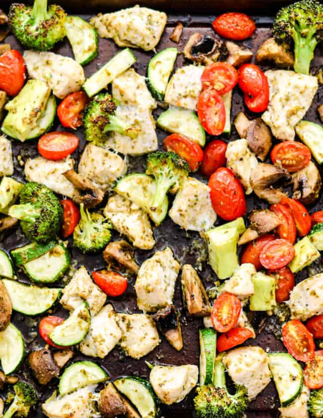 sheet pan pesto chicken with broccoli, mushrooms, and tomatoes