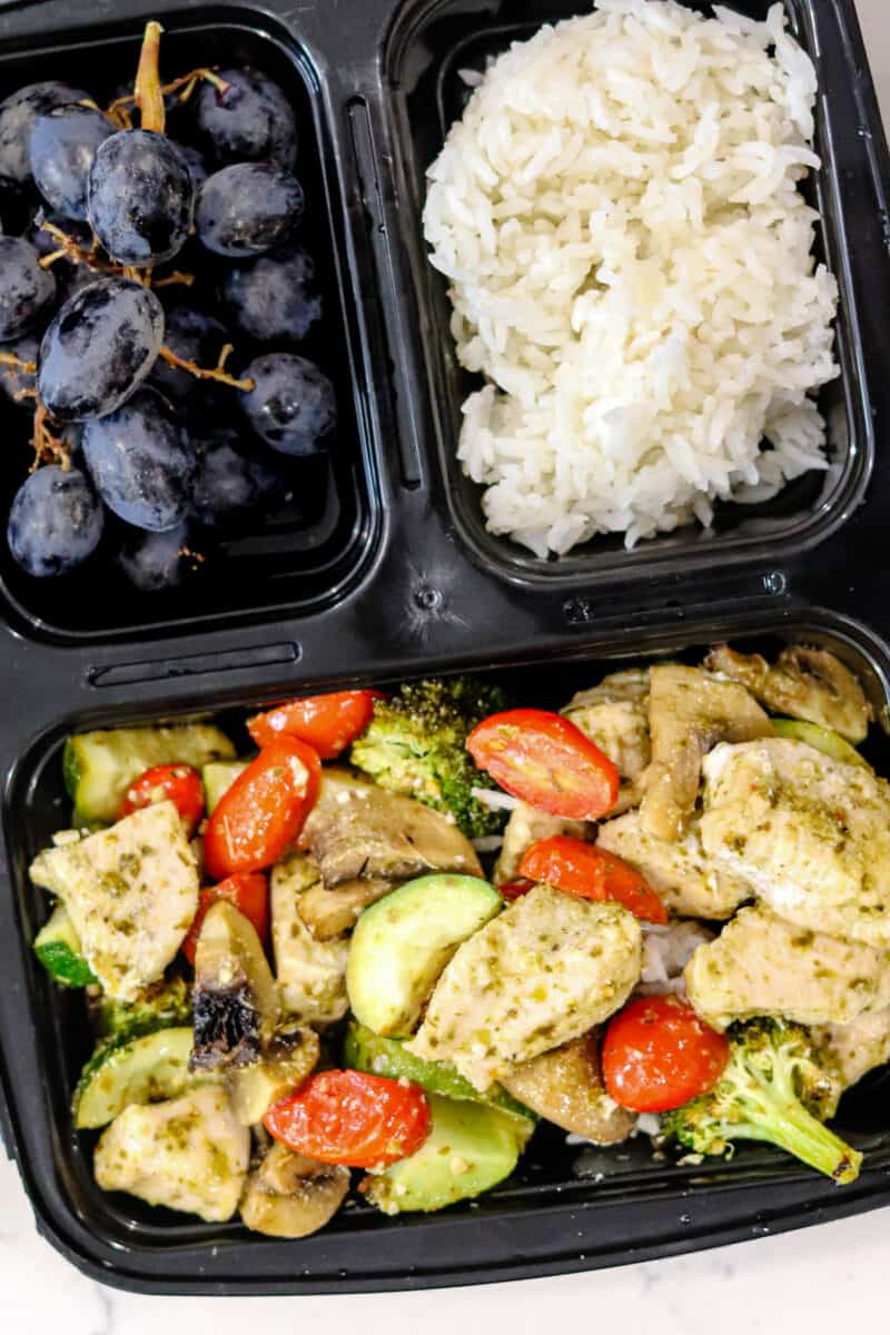 lunch with pesto chicken, grapes, and rice