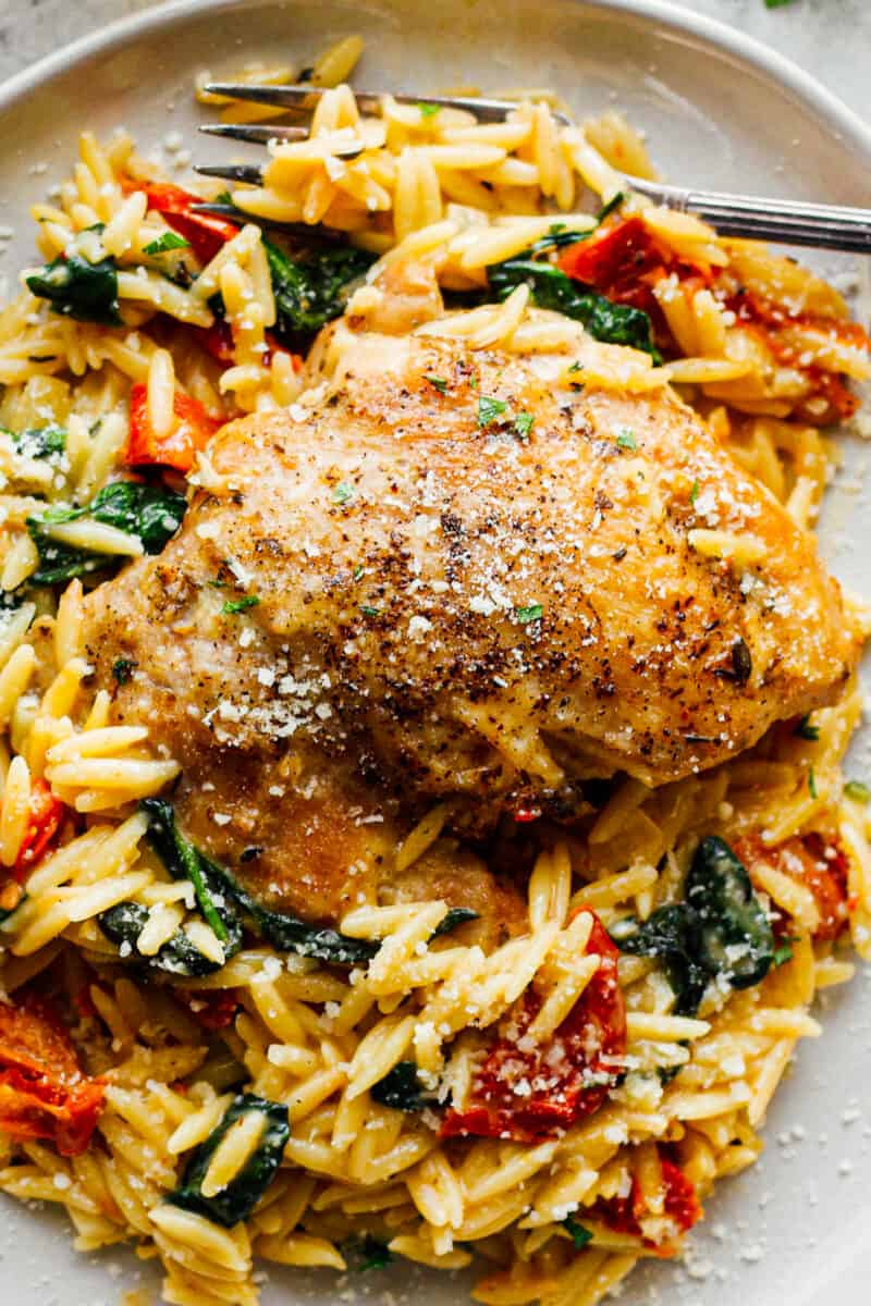white plate with tuscan chicken and orzo