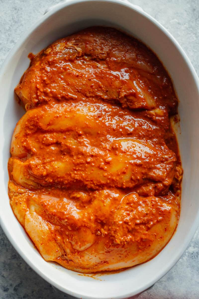 chipotle chicken breasts in baking dish